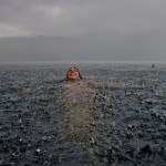 National-Geographic-traveler-photo-contest2012-10-Swimming-Rain-Camila-Massu-Lago-Caburgua-Chile