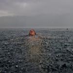 National-Geographic-traveler-photo-contest2012-10-Swimming-Rain-Camila-Massu-Lago-Caburgua-Chile