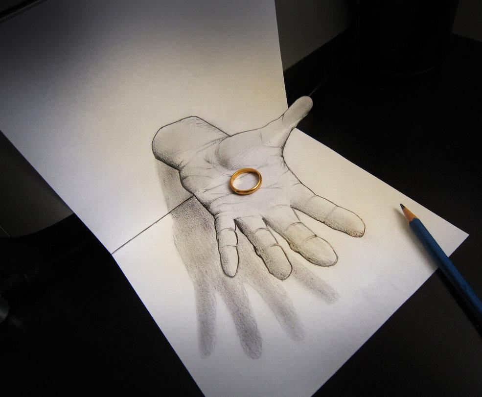 Dessin 3d : un anneau tenu par un main dessinée. Anamorphose d'Alessandro Diddi.