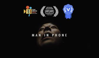 man in phone - Mackenzie Sheppard