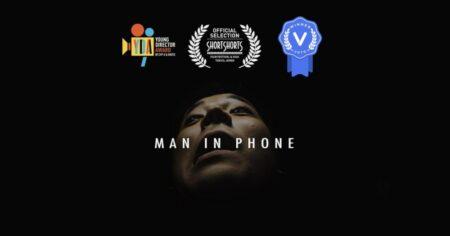 man in phone - Mackenzie Sheppard