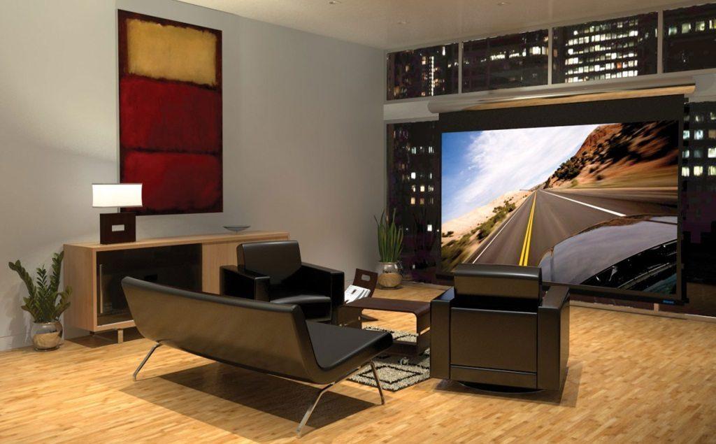 salon home cinéma avec un grande télé au sol